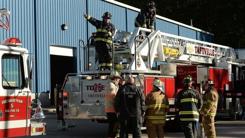 Firefighters are seen at the scene of a fire Thursday, Oct.18, 2018, at Atlantic City Linen Supply located at 5 Consumers Ave. in Norwich.  (Dana Jensen/The Day)
