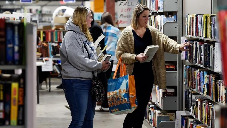 Melissa Jenkins, left, of Norwich and Charlotte Rogers of North Franklin select books from the shelves at the semiannual Friends of Otis Library Book Sale on its opening day Friday, Oct. 19, 2018.  (Sean D. Elliot/The Day)