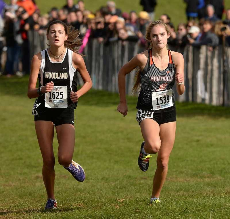 Montville's Mady Whittaker, right, and Woodland's Emma Slavin sprint to the finish line during the Class SS girls' country country race at Wickham Park in Manchester. Slavin finished ninth and Whittaker 10th to qualify for next week's State Open. (Dana Jensen/The Day)