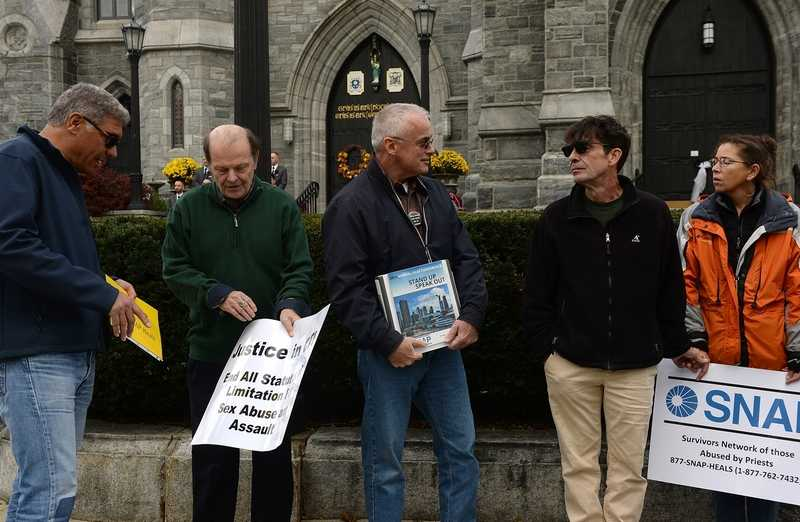 People with the Connecticut chapter of Survivors Network of Those Abused by Priests, or SNAP, protest Saturday, Nov. 3, 2018, outside Cathedral of St. Patrick in Norwich.  (Dana Jensen/The Day)