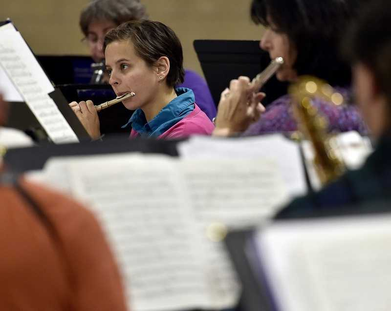 Alyssa Christian plays the flute during a rehearsal with the Noank-Mystic Community Band at the City of Groton Municipal Building on Wednesday, Nov. 7, 2018.  The band is celebrating its 40th anniversary at its fall concert at 7 p.m. Friday at the Municipal Building. (Sarah Gordon/The Day)