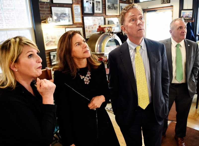 Muddy Waters co-owner Susan Devlin, left, offers menu guidance to Lt. Gov.-elect Susan Bysiewicz, Gov.-elect Ned Lamont and Mayor Michael Passero on Friday, Nov. 9, 2018. Lamont and Bysiewicz met with local leaders in the morning at the Garde Arts Center's Oasis Room, and then had lunch at Muddy Waters. (Sean D. Elliot/The Day)