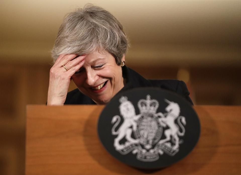 Britain's Prime Minister Theresa May reacts during a press conference inside 10 Downing Street in London, Thursday, Nov. 15, 2018. Two British Cabinet ministers, including Brexit Secretary Dominic Raab, resigned Thursday in opposition to the divorce deal struck by May with the EU — a major blow to her authority and her ability to get the deal through Parliament. (AP Photo/Matt Dunham, Pool)