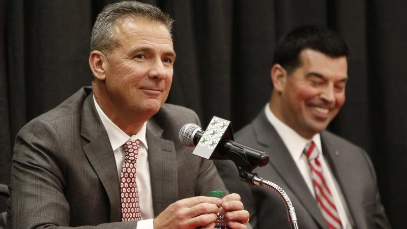 Ohio State football head coach Urban Meyer, left, answers questions during Tuesday's news conference announcing his retirement in Columbus, Ohio. At right is assistant coach Ryan Day, who will take over as head coach. (Jay LaPrete/AP Photo)
