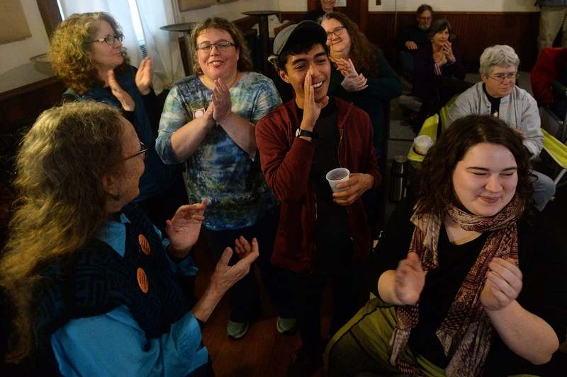People applaud and cheer at the end of a song during the Mystic Chantey Blast & Pub Sing at Frohsinn Hall in Mystic on Saturday, Jan. 5, 2019.  Donations from the event will help support the Mystic Seaport Sea Music Festival in June.  (Dana Jensen/The Day)