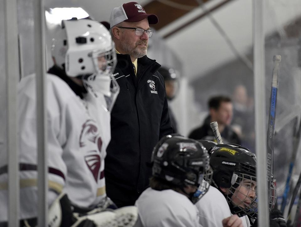 Coach Randy Craig, who guided the Eastern Connecticut Eagles coooperative hockey prorgram to its first state championship in 2018, watches from the bench during a recent game against Woodstock Academy at Connecticut College's Dayton Arena in New London. (Sarah Gordon/The Day)