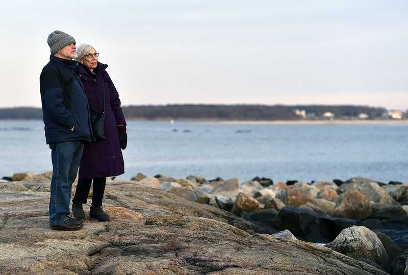 Michael Gilbert and his wife Adele Gladstone-Gilbert, visiting from Amherst Massachusetts, take a walk along the Dodge Paddock/Beal Preserve on Tuesday, January 15, 2018 in Stonington.  The couple is visiting the area for their 40th anniversary.  (Sarah Gordon/The Day)