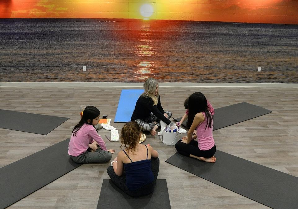 A youth class in the Yoga Center of the newly renovated Naik Family YMCA in Mystic Thursday, Jan. 17, 2019.  (Dana Jensen/The Day)