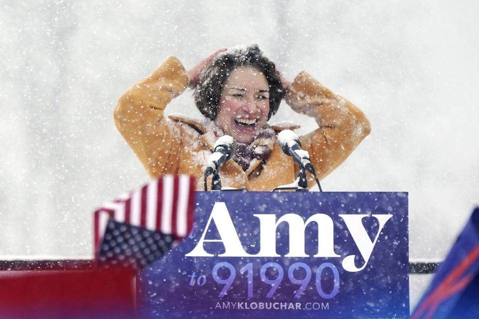 U.S. Sen. Amy Klobuchar wipes snow from her hair after announcing she is running for president of the United States, at Boom Island Park, Sunday, Feb. 10, 2019, in Minneapolis. Klobuchar joined the growing group of Democrats jostling to be president and positioned herself as the most prominent Midwestern candidate in the field, as her party tries to win back voters in a region that helped put Donald Trump in the White House. (Anthony Souffle/Star Tribune via AP)