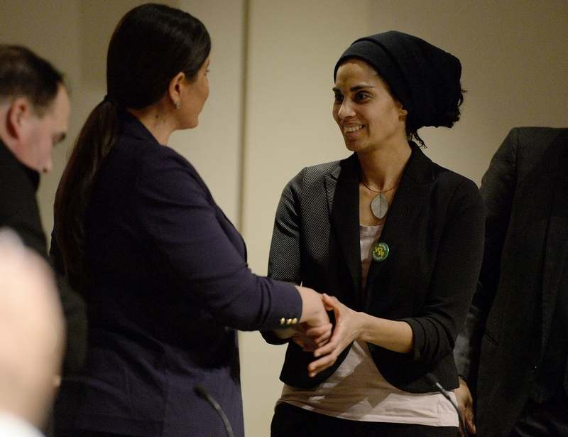 Board of Education member Mirna Martinez shakes hands with fellow candidate Kat Goulart, a Republican, during a debate for the 39th District state House seat at the Science and Technology Magnet High School on Wednesday, Feb. 20, 2019, in New London. A special election will be held Feb. 26 to replace State Rep. Chris Soto, a Democrat who resigned to take a position with Gov. Ned Lamont's administration. The debate was sponsored by The Day and the League of Women Voters of Southeastern Connecticut.  (Sarah Gordon/The Day)