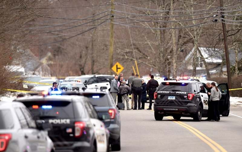 Several police cars involved in a Wednesday, Feb. 20, 2019 chase that started in Norwich are parked in front of the Windham IGA on Route 32. (Sean Elliot/The Day)