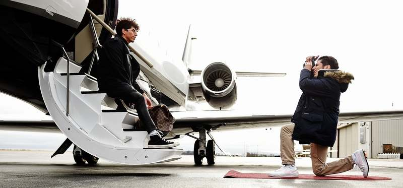 Local social media influencer Jean Michael Coronado poses for photos on the steps of a Cessna Citation Sovereign business jet with his brother Christian Coronado behind the camera Thursday, Feb. 7, 2019, at Mystic Jet Center at Groton-New London Airport. Coronado leverages his more than 8,000 Instagram followers to promote brands and companies. (Sean D. Elliot/The Day)