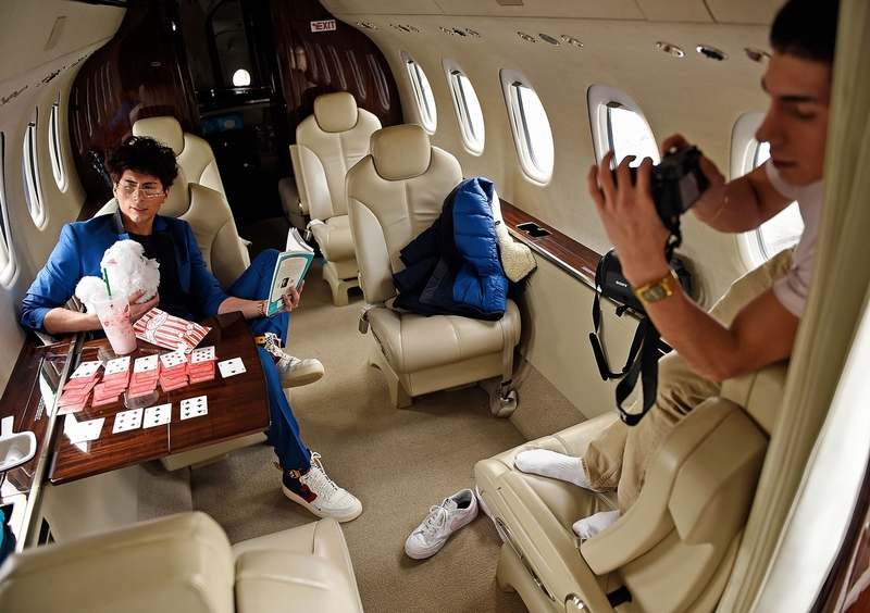Social media influencer Jean Michael Coronado, left, poses for photos in the cabin of a Cessna Citation Sovereign business jet with his brother Christian Coronado behind the camera Thursday, Feb. 7, 2019, at Mystic Jet Center at Groton-New London Airport. Coronado leverages his more than 8,000 Instagram followers to promote brands and companies. (Sean D. Elliot/The Day)
