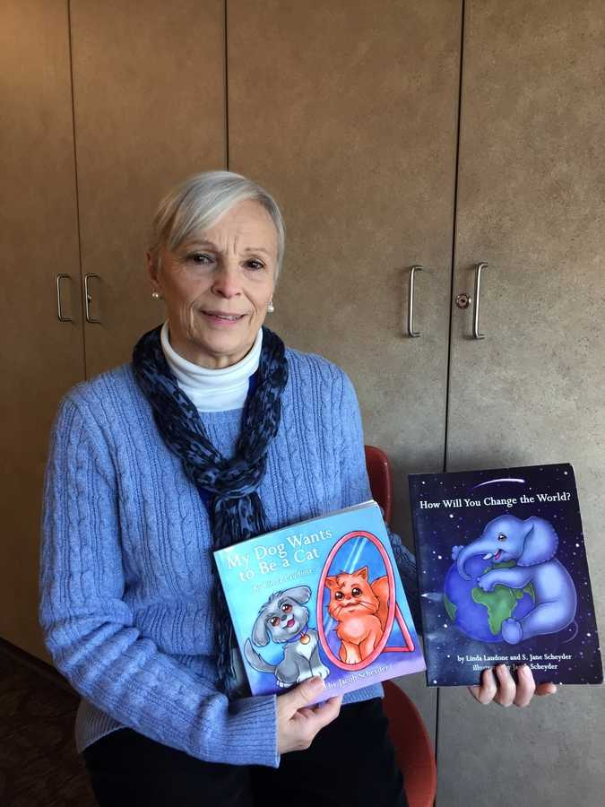 Linda Laudone poses with her two children's books at Waterford High School. (Photo by Jack Lange)