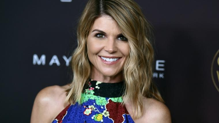 In this Oct. 4, 2017, file photo, actress Lori Loughlin arrives at the 5th annual People Magazine