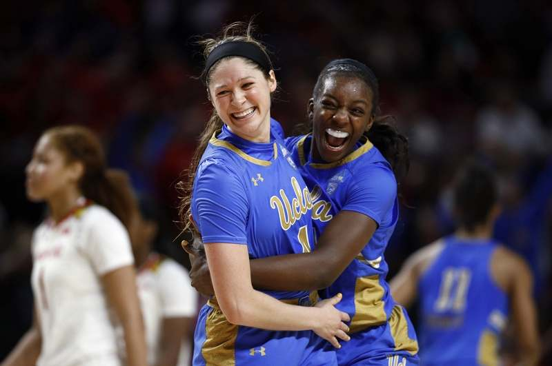 UCLA's Lindsey Corsaro, left, and forward Michaela Onyenwere celebrate after the sixth-seeded Bruins upset No. 3 Maryland 85-80 on Monday night in College Park, Md. UCLA will faced No. 2 UConn on Friday in the NCAA Sweet 16 in Albany, N.Y. (AP Photo/Patrick Semansky)