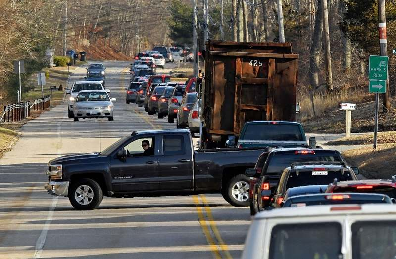 A driver opts to turn around and get out of standstill traffic on Route 117 northbound between I-95 and Route 184 as traffic clogs the surface roads in Groton after a crane downed power lines on I-95 in the area closing the highway and creating a traffic mess throughout the town Tuesday, April 2, 2019. (Sean D. Elliot/The Day)