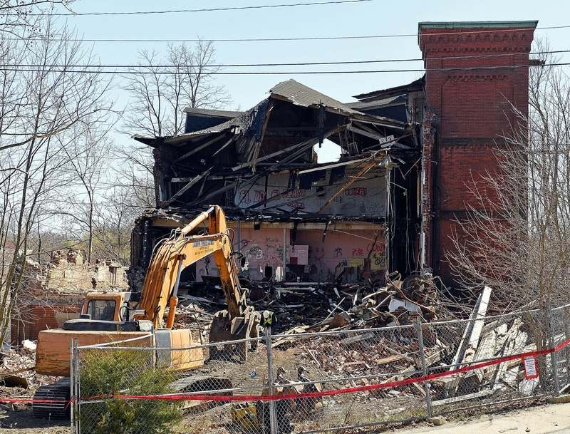 Work on the demolition of the abandoned Connecticut Casting mill at 75 Stillman Ave. in Pawcatuck came to a stop for a few hours Tuesday, April 16, 2019, amid concerns over possible contamination on the site. The demolition has since been completed. (Sean D. Elliot/The Day)