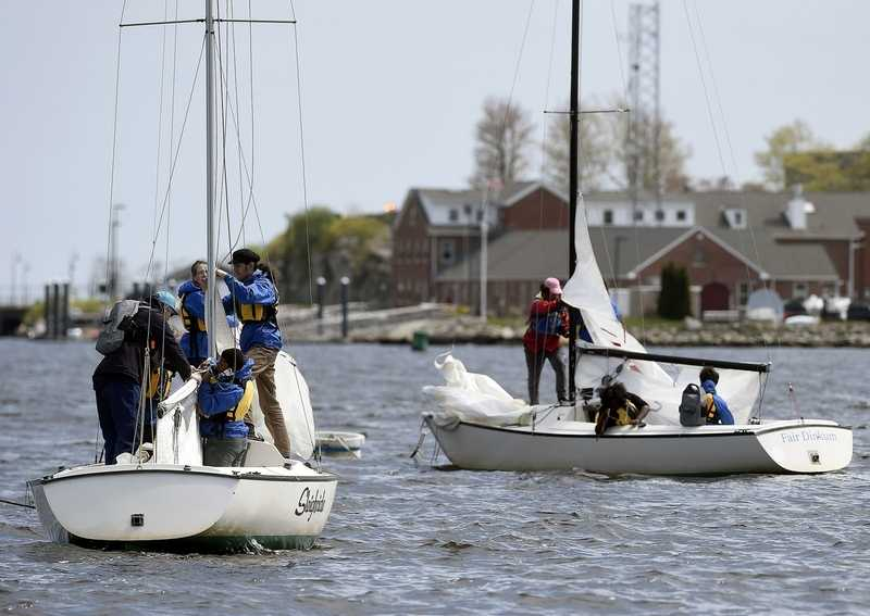 Students from the Science and Technology Magnet High School and Bennie Dover Jackson Middle School work on sailing techniques during an after-school enrichment program with New England Science & Sailing Foundation on Thursday, May 9, 2019, off New London's Waterfront Park. (Sarah Gordon/The Day)