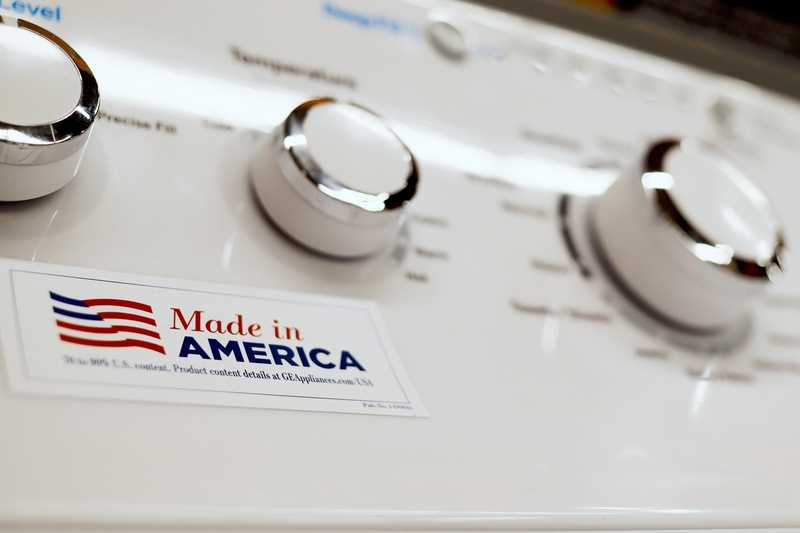 In this May 9, 2019, photo a General Electric washing machine with a label advertising it was made in America is displayed in retail stores in Cranberry Township, Pa. China has announced tariff hikes on $60 billion of U.S. goods in retaliation for President Donald Trump's escalation of a fight over technology and other trade disputes. The Finance Ministry said Monday, May 13, the penalty duties of 5 percent to 25 percent on hundreds of U.S. products including batteries, spinach and coffee take effect June 1. (AP Photo/Keith Srakocic)