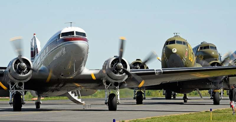 World War II vintage C-47 aircraft with the D-Day Squadron start their engines Saturday, May 18, 2019, to depart Waterbury-Oxford Airport for a flyover of the Statue of Liberty on the final day of the squadron's kickoff week. The 11 aircraft will depart Sunday morning for Normandy, France, where they will lead an American fleet of restored WWII military aircraft in Daks over Normandy, a flyover of more than 30 international aircraft to drop 250 paratroopers in commemoration of the 75th anniversary of D-Day. (Sean D. Elliot/The Day)