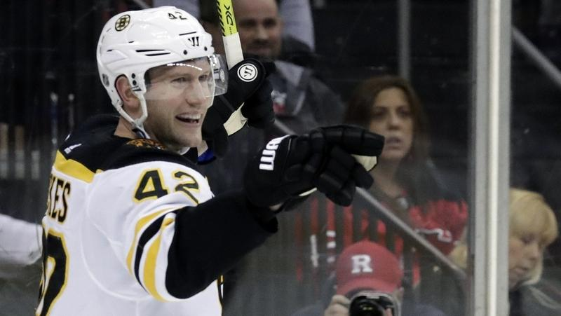 In this March 21 file photo, David Backes of the Boston Bruins celebrates after scoring against the New Jersey Devils during the third period of a game in Newark, N.J. (AP Photo/Julio Cortez)