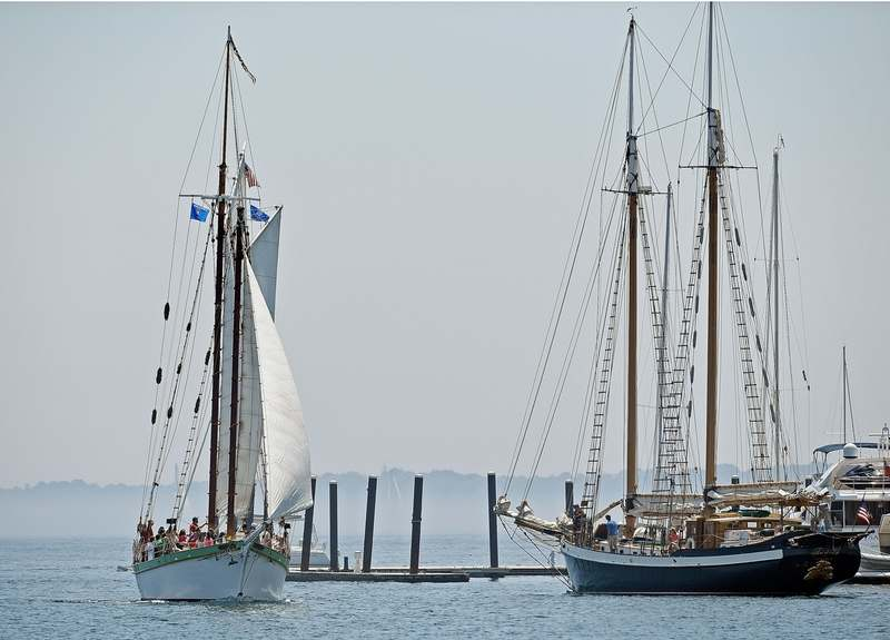 The Mystic schooner Argia, left, returning from a day sail on Fishers Island Sound, on Friday, July 5, 2019, passes the outbound Newport, R.I., schooner Tree of Life in the Mystic River off Noank Shipyard.  (Sean D. Elliot/The Day)
