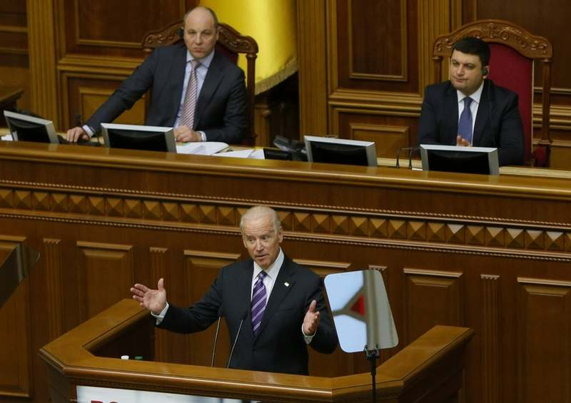 In this file photo taken on Tuesday, Dec. 8, 2015, U.S. Vice President Joe Biden addresses the Ukraine Parliament in Kyiv, Ukraine. Ukrainian President Volodymyr Zelenskiy's first 100 days in power were marked by his efforts to advance a peaceful solution to the armed conflict in the country's east, fomented by Russia. Now, he is caught up in a political furor involving the United States, Ukraine's ally and backer. (AP Photo/Sergei Chuzavkov, Pool, File)