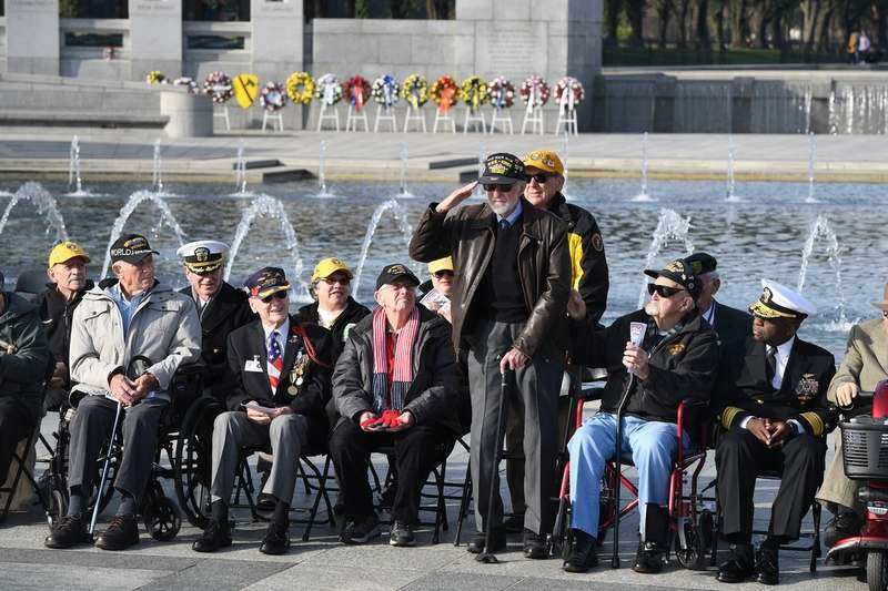 Frederick Clinton, a 92-year-old Alexandria, Va., veteran of World War II, Korea and Vietnam, stands and salutes during a Veterans Day ceremony at the World War II Memorial in Washington on Monday, Nov. 11, 2019. (Washington Post photo by Matt McClain)