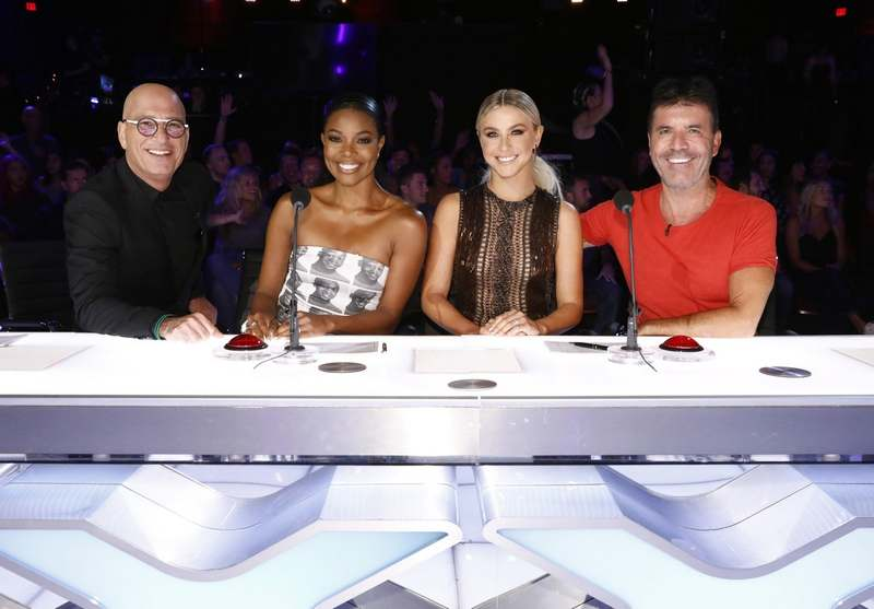 "This image released by NBC shows celebrity judges, from left, Howie Mandel, Gabrielle Union, Julianne Hough and Simon Cowell on the set of 'America's Got Talent,' in Los Angeles. Union is thanking supporters for defending her amid reports she was fired from ""America's Got Talent"" after complaining about racism and other on-set issues. Without directly addressing her status with NBC's talent show, the actress tweeted that the backing helped overcome feeling of being lost and alone. 