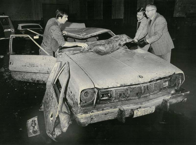 Inspectors, from left, Thomas Viens, Richard Rainville and Edward F. Pickett of the state's attorney's office examine the car in which the body of Coast Guard Warrant Officer Richard E. Eastman was found Oct. 16, 1979. (Robert Patterson/The Day, file)