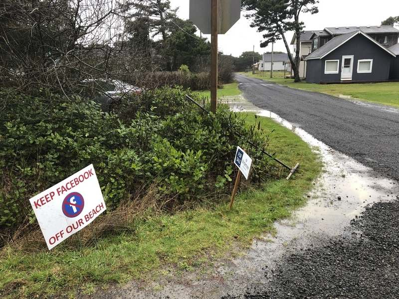 A sign expressing opposition to a plan by Facebook to build a landing spot for a submarine cable connecting America with Asia stands on property in the tiny community of Tierra del Mar, Ore., Wednesday, Jan. 8, 2020. (AP Photo/Andrew Selsky)