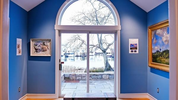"""The newly renovated Terrace Gallery at Mystic Museum of Art serves as the new """"Adopt-a-Painting Gallery."""" (Sean D. Elliot/The Day)"""