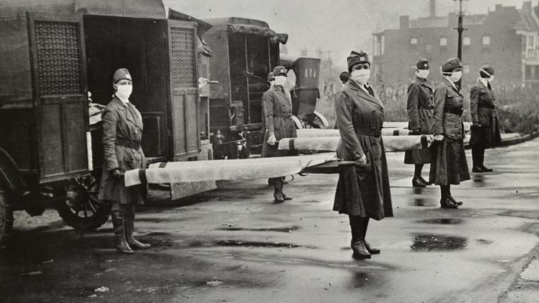 Wearing masks for protection, members of the St. Louis Red Cross Motor Corps are seen on duty in October 1918, the worst month of the epidemic. (Library of Congress)