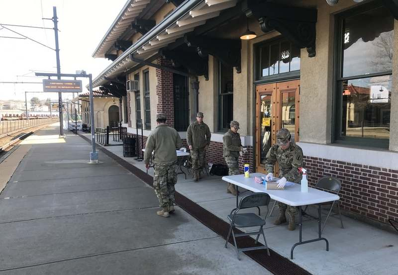 Rhode Island National Guard members set up a checkpoint at the Westerly train station Friday, March 27, 2020, after Rhode Island Gov. Gina Raimondo ordered arriving New Yorkers to be questioned. (David Collins/The Day)