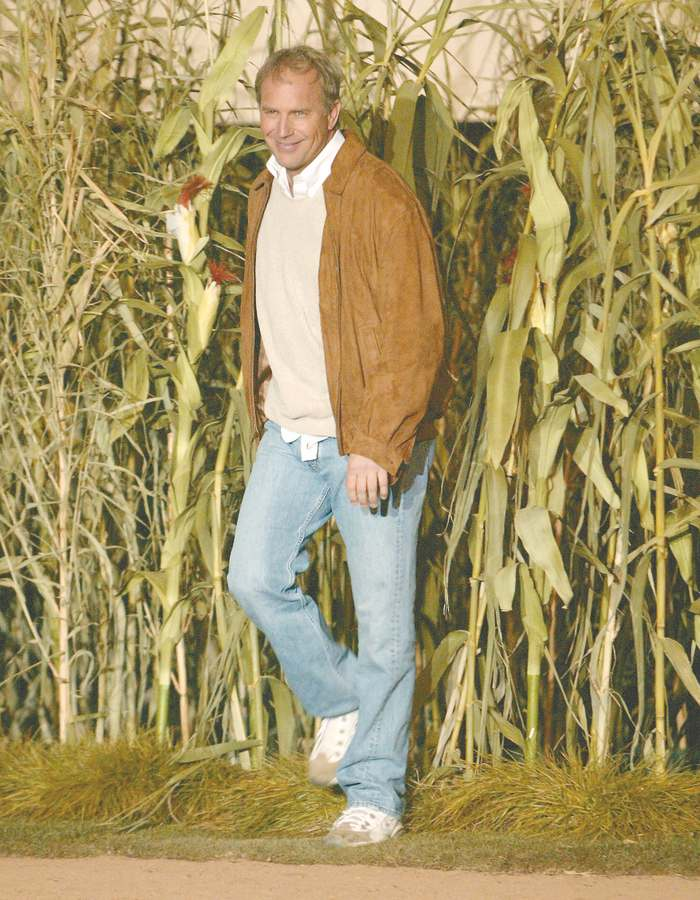 Kevin Costner emerges from rows of cornstalks, as part of the celebration for the DVD release of the