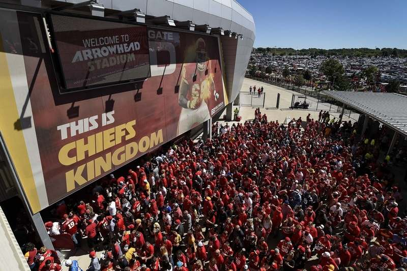 In this 2016 file photo, Kansas City Chiefs fans line up to enter Arrowhead Stadium before their NFL game against the San Diego Chargers. The crippling coronavirus pandemic has brought the entire world — including the sports world — to a standstill, and it shows no sign of going away anytime soon. That has left fans, stadium workers, team owners, sponsors and yes, even players, wondering what life will be like when games finally resume. (AP Photo/Reed Hoffmann, File)