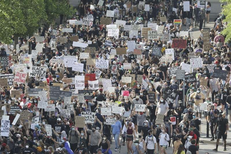 Demonstrators take part in a protest march Thursday, June 4, 2020, in Nashville, Tenn., over the death of George Floyd, who died May 25 after being restrained by police in Minneapolis. (AP Photo/Mark Humphrey)