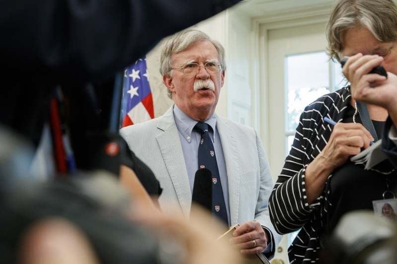 In this July 19, 2019, file photo, then-National Security Adviser John Bolton speaks at the request of President Donald Trump during a photo opportunity in the Oval Office of the White House in Washington. Top officials in the White House were aware in early 2019 of classified intelligence indicating Russia was secretly offering bounties to the Taliban for the deaths of Americans, a full year earlier than has been previously reported. That's according to U.S. officials with direct knowledge of the intelligence. Bolton also told colleagues he briefed Trump on the intelligence assessment in March 2019.  (AP Photo/Alex Brandon, File)
