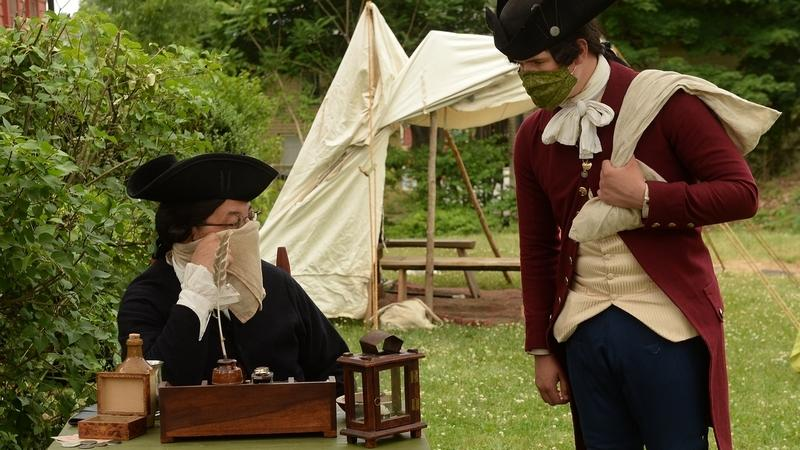 Robert Lecce, left, portraying an official on the committee of safety recruiting enlistments for the Revolutionary War, talks to John McGough, portraying a civilian, during the Be Revolutionary event Saturday, July 4, 2020, at the Leffingwell House Museum in Norwich.  (Dana Jensen/The Day)