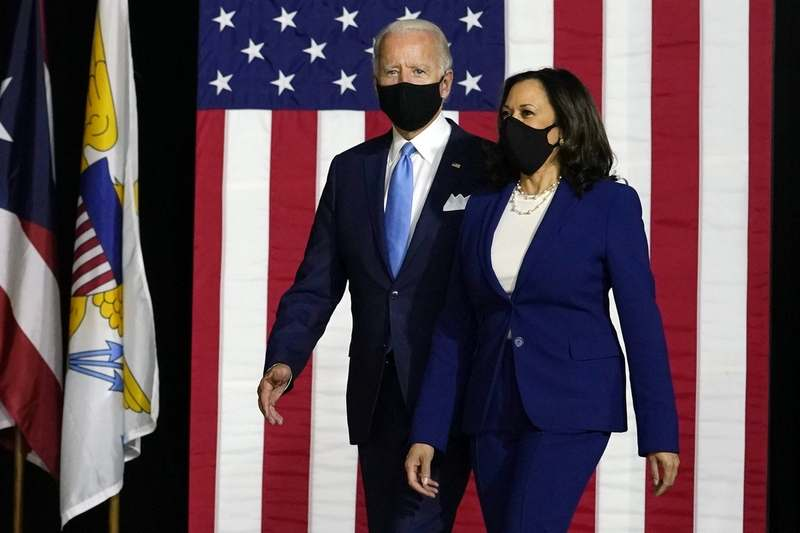 Democratic presidential candidate former Vice President Joe Biden and his running mate Sen. Kamala Harris, D-Calif., arrive Wednesday, Aug. 12, 2020, to speak at a news conference at Alexis Dupont High School in Wilmington, Del. (Carolyn Kaster/AP Photo)
