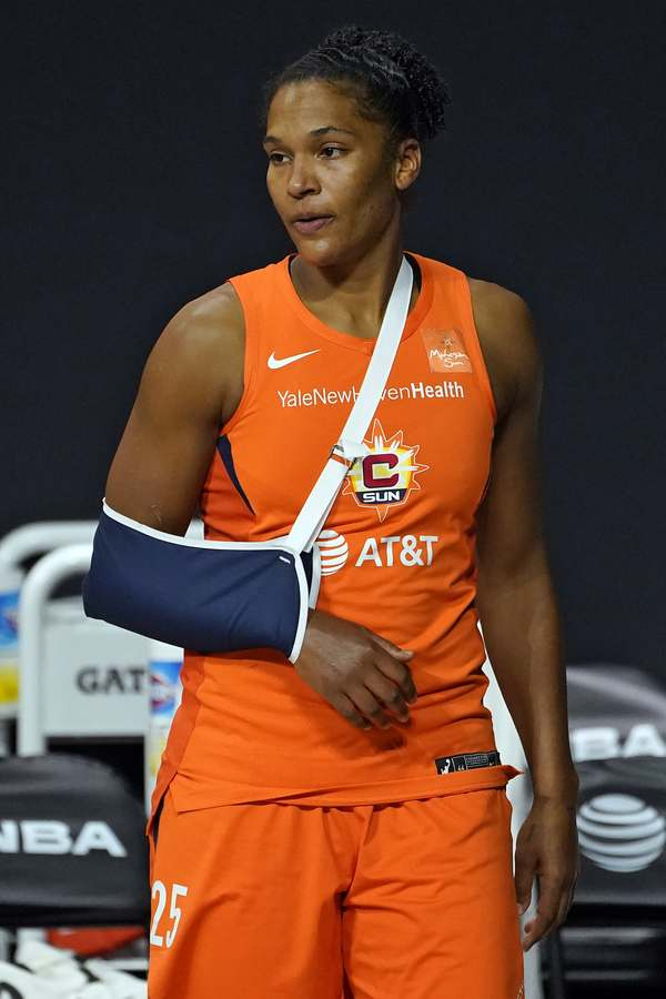 Connecticut Sun forward Alyssa Thomas (25) watches from the bench after getting injured during the second half of Game 2 of a WNBA basketball semifinal round playoff series against the Las Vegas Aces Tuesday, Sept. 22, 2020, in Bradenton, Fla. (AP Photo/Chris O'Meara)