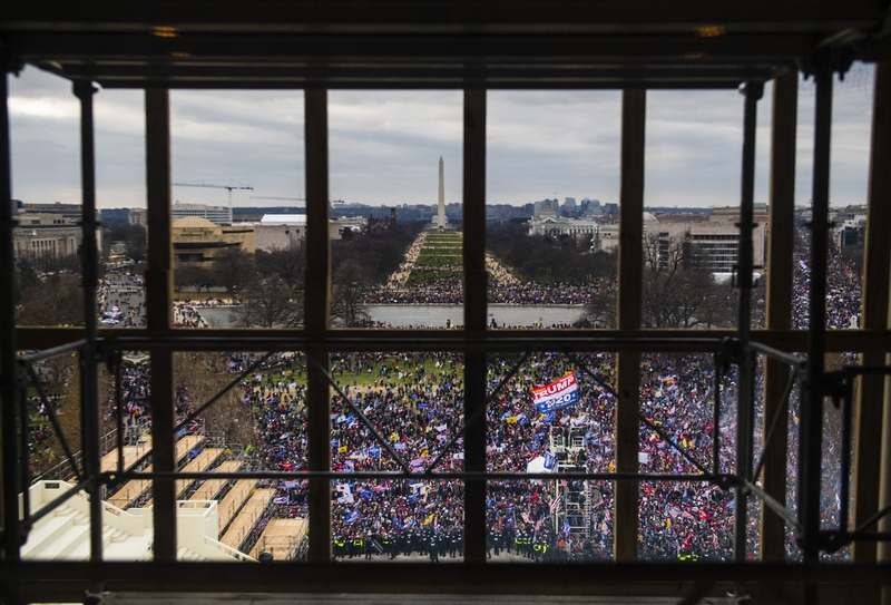 Rioters surround the Capitol on Wednesday, Jan. 6, 2021. (Photo by Amanda Voisard for The Washington Post)