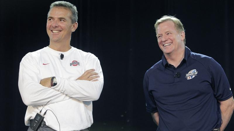NFL Commissioner Roger Goodell, right, and Ohio State head coach Urban Meyer answer questions during a 2013 safety clinic for mothers of youth football players in Columbus, Ohio. Meyers has accepted the head coaching position with the Jackonsville Jaguars. (AP Photo/Jay LaPrete, File)