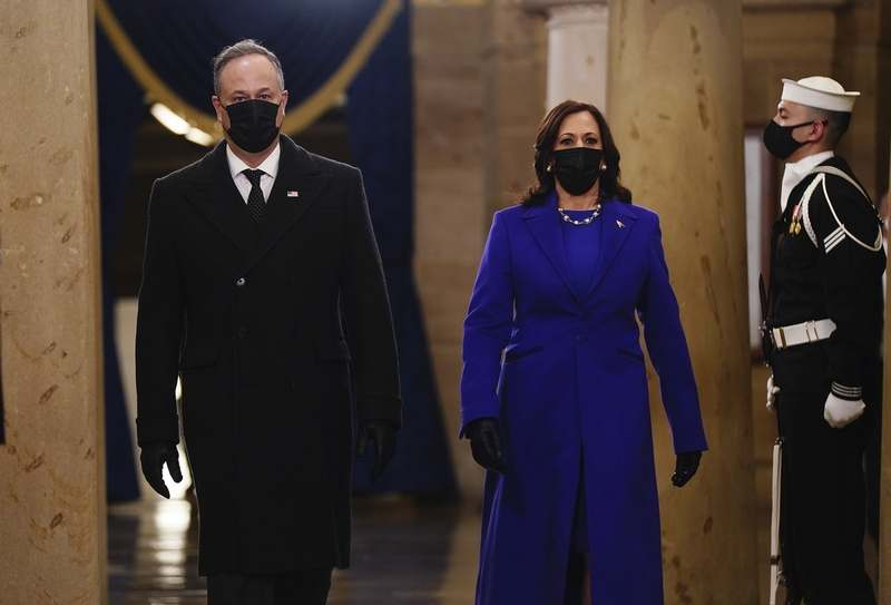 Vice President-elect Kamala Harris  and Doug Emhoff arrive in the Crypt of the US Capitol for President-elect Joe Biden's inauguration ceremony on Wednesday, Jan. 20, 2021 in Washington. (Jim Lo Scalzo (Jim Lo Scalzo/Pool Photo via AP)