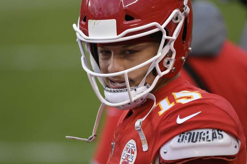 Chiefs quarterback Patrick Mahomes walks on the sideline during the second half of an AFC divisional playoff game against Cleveland on Sunday in Kansas City. (Reed Hoffmann/AP Photo)