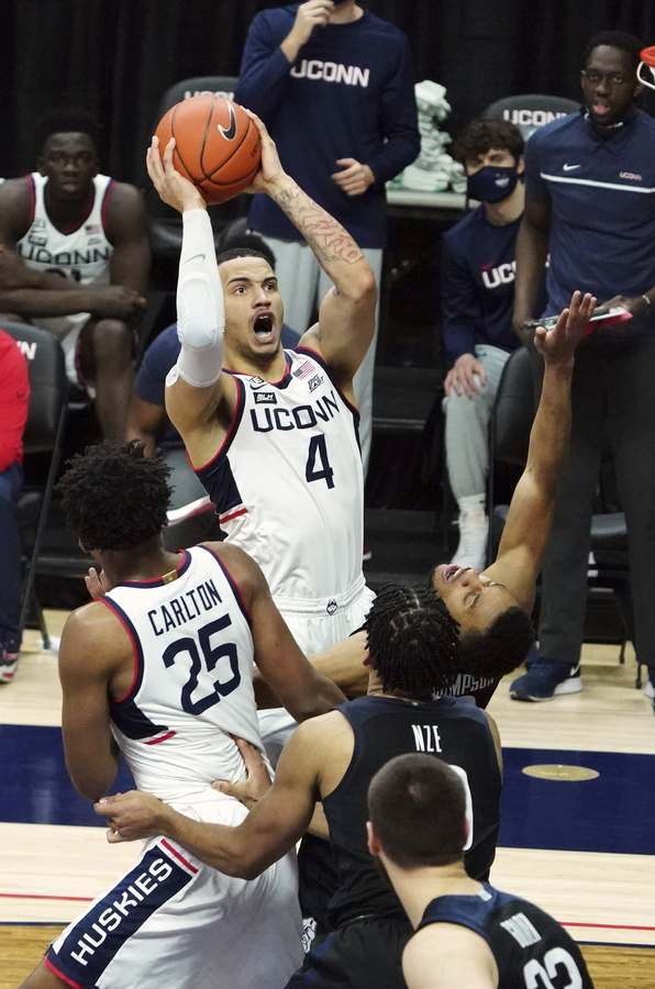 UConn guard Tyrese Martin (4) shoots the ball against Butler during the second half of Tuesday's game in Storrs. (David Butler II/Pool Photo via AP)