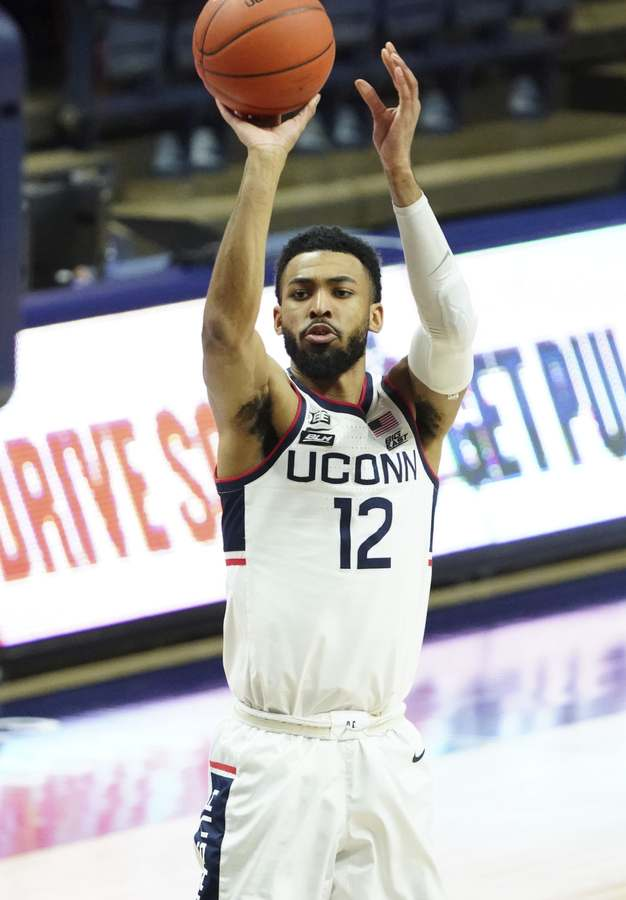 UConn forward Tyler Polley elevates for a jump shot during Saturday's Big East game against Georgetown in Storrs. (David Butler II/Pool Photo via AP)