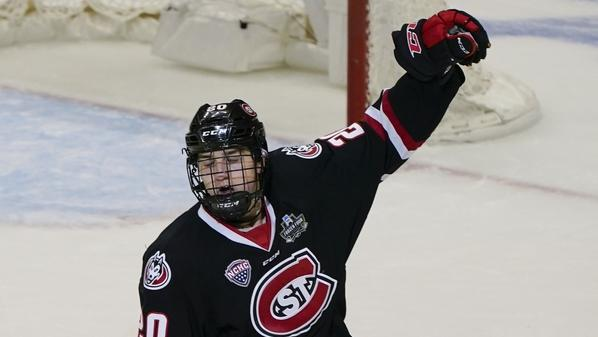 St. Cloud State's Nolan Walker celebrates after scoring the go-ahead goal with less than a minute left to break a tie against Minnesota State during the third period of an NCAA men's Frozen Four hockey semifinal on Thursday, April 8, 2021 in Pittsburgh. St. Cloud State won 5-4 to advance to Saturday's championship game. (Keith Srakocic/AP Photo)