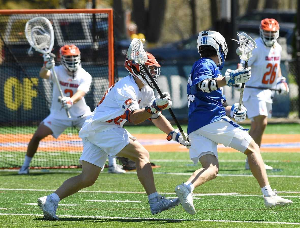 Coast Guard´s Tyson Fenn (36) defends against Wheaton´s Shane Ross (33) during the NEWMAC lacrosse tournament semifinal game at the Coast Guard Academy Saturday, May 1, 2021, in New London.  (Dana Jensen/The Day)